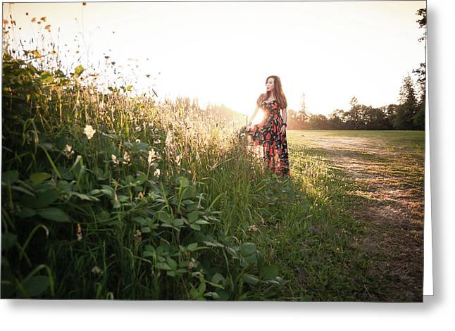 Woman Standing Among Wildflowers In Meadow At Sunset Greeting Card