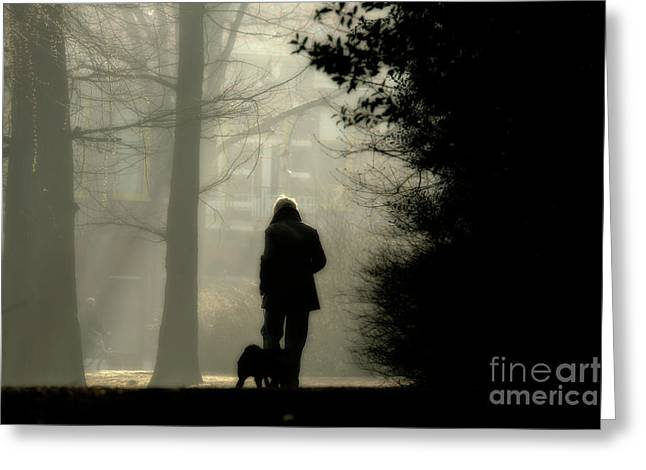 Greeting Card featuring the photograph Woman Walking Dog by Patricia Hofmeester