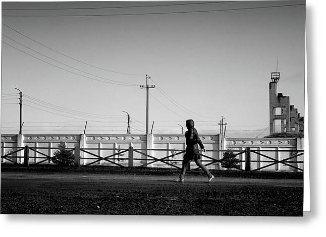 Greeting Card featuring the photograph Woman Walking In Industry by John Williams