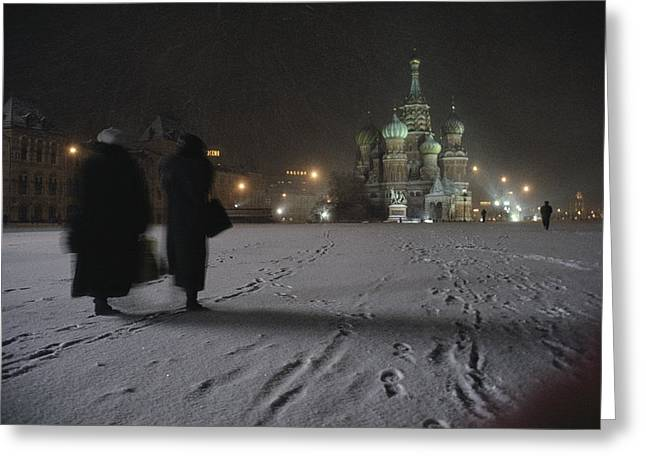 Women Walk Through The Snow To St Greeting Card