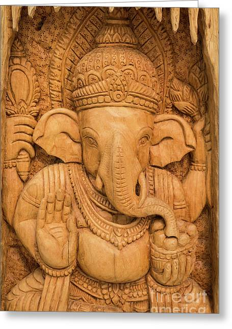 Greeting Card featuring the photograph wood carving for Hindu god Ganesha on the wood. by Tosporn Preede