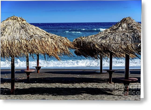 Wood Thatch Umbrellas On Black Sand Beach, Perissa Beach, In Santorini, Greece Greeting Card