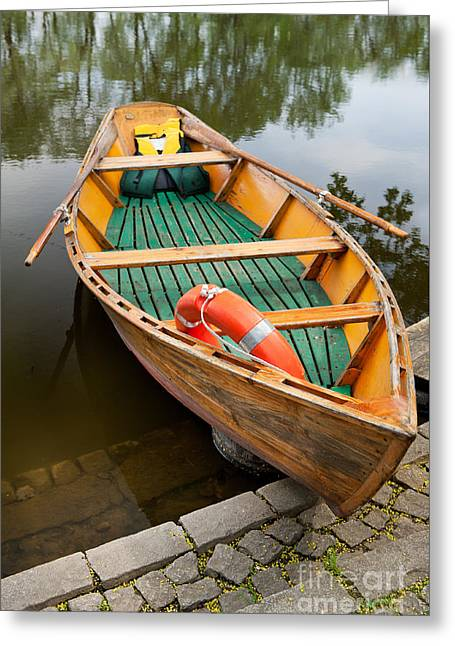 Wooden Boat With Oars And Lifebelt Greeting Card