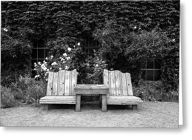 Wooden Chairs And Table In Overgrown Garden Greeting Card by Bradley Hebdon