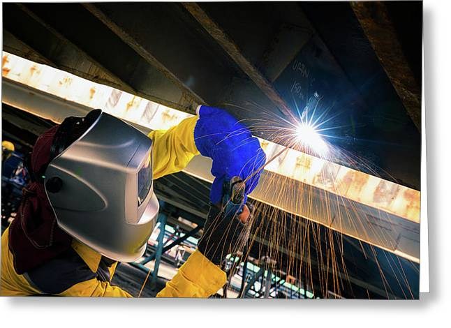 Worker Welding For Repair Bottom Side Of Container Box Greeting Card by Anek Suwannaphoom