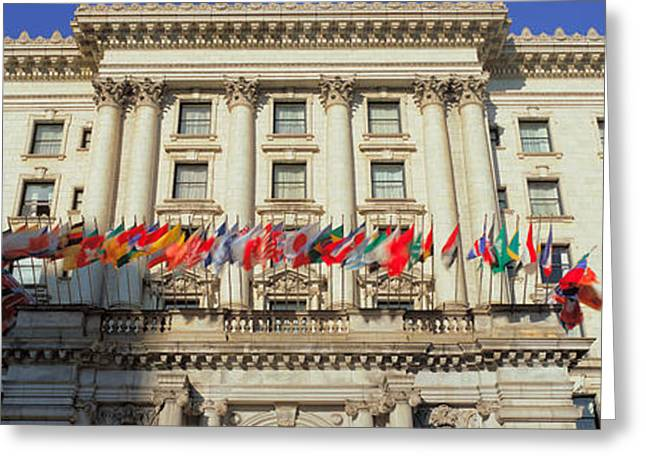 World Flags Blow In The Breeze In Front Greeting Card by Panoramic Images