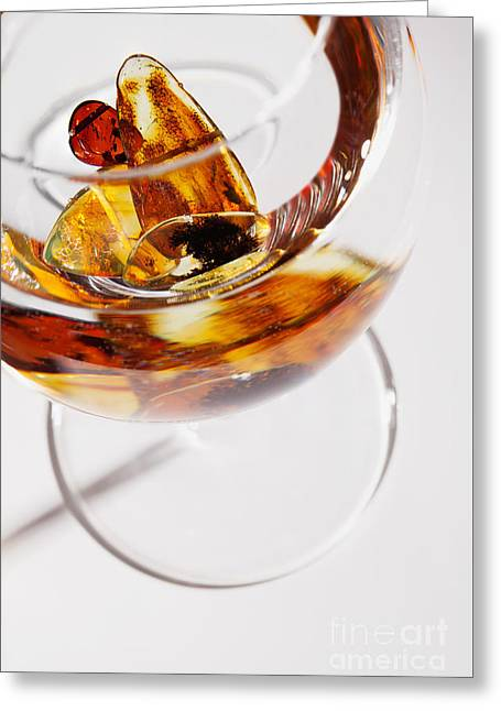 Greeting Card featuring the photograph Yellow Amber Stones In A Glass. by Andrey  Godyaykin