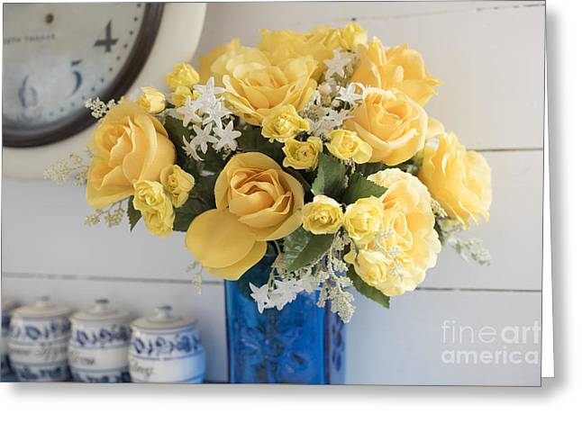 Yellow Flowers In A Blue Vase Greeting Card by Juli Scalzi