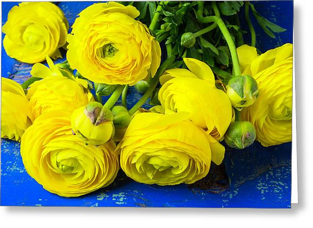 Yellow Ranunculus On Blue Table Greeting Card by Garry Gay