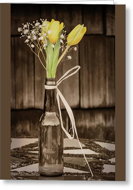 Greeting Card featuring the photograph Yellow Tulips In Glass Bottle Sepia by Terry DeLuco