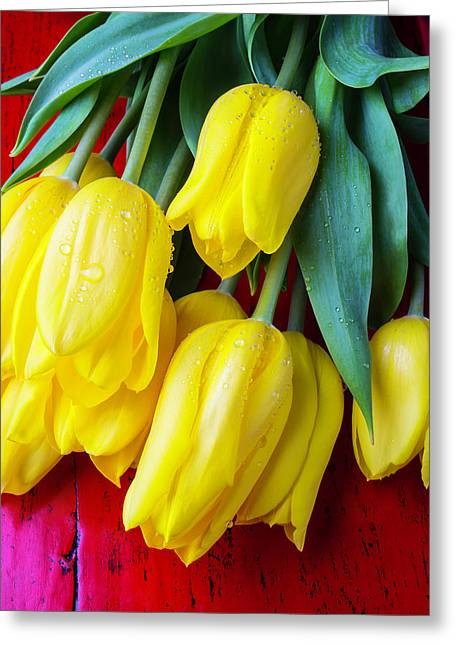 Yellow Tulips On Red Table Greeting Card by Garry Gay