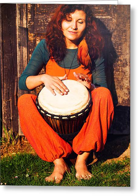 Young Barefoot Lady Drummer Playing On Her Djembe Drum On Rustic Wooden Door Background. Greeting Card by Jozef Klopacka