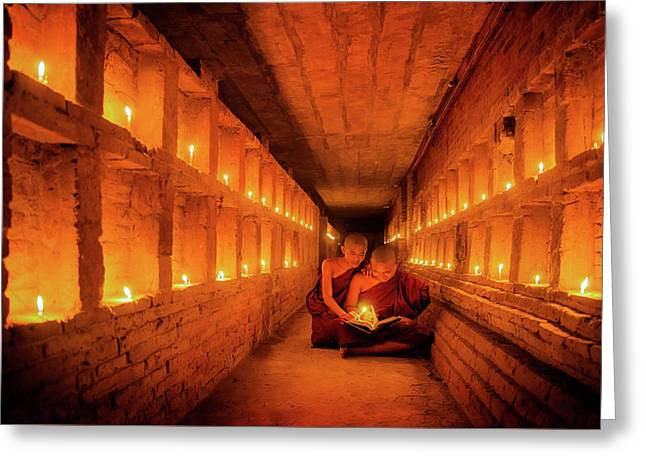 Young Buddhist Monk Are Reading A Book With Light From Candle  Greeting Card by Anek Suwannaphoom
