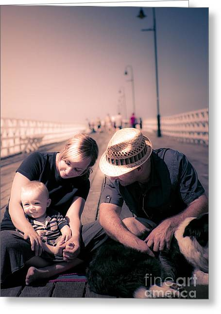 Young Couple And Baby Boy Sitting On The Boardwalk Greeting Card by Jorgo Photography - Wall Art Gallery