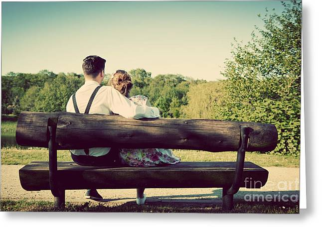 Young Couple In Love Sitting On A Bench In Park Greeting Card