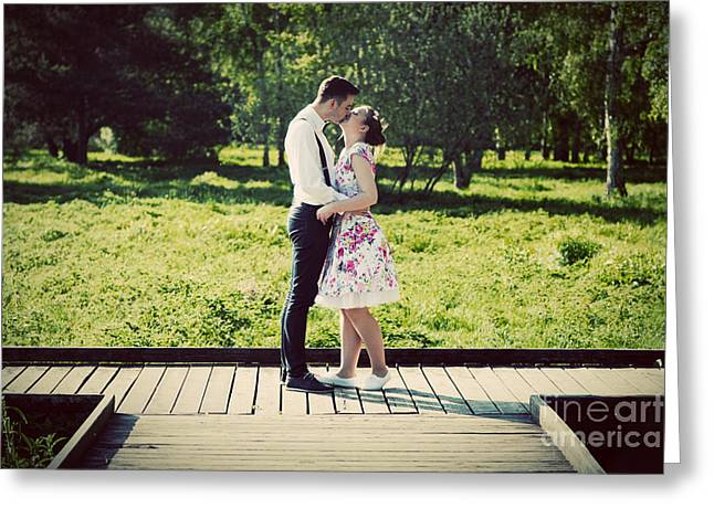 Young Couple In Love Standing On Wooden Cross-roads Greeting Card