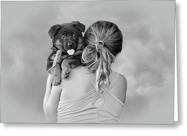 Young Girl And Puppy Greeting Card