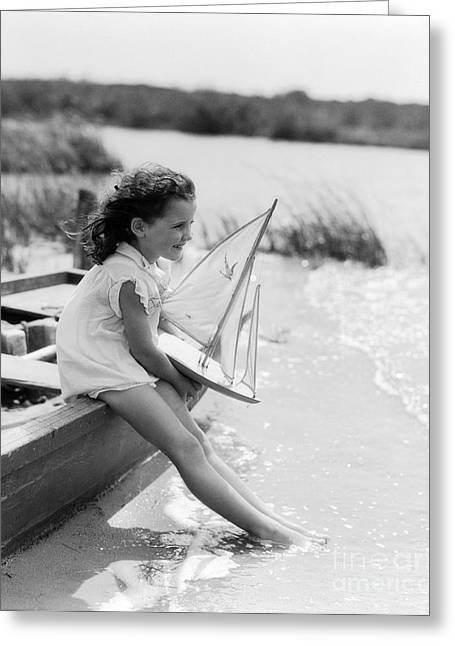 Young Girl At Seashore Holding Greeting Card