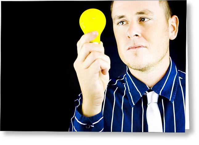 Young Man Holding Light Bulb In Hand Greeting Card by Jorgo Photography - Wall Art Gallery