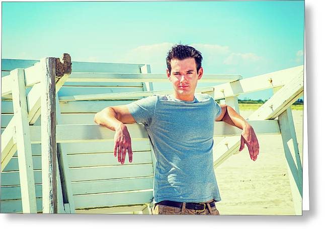 Young Man Relaxing On The Beach Greeting Card