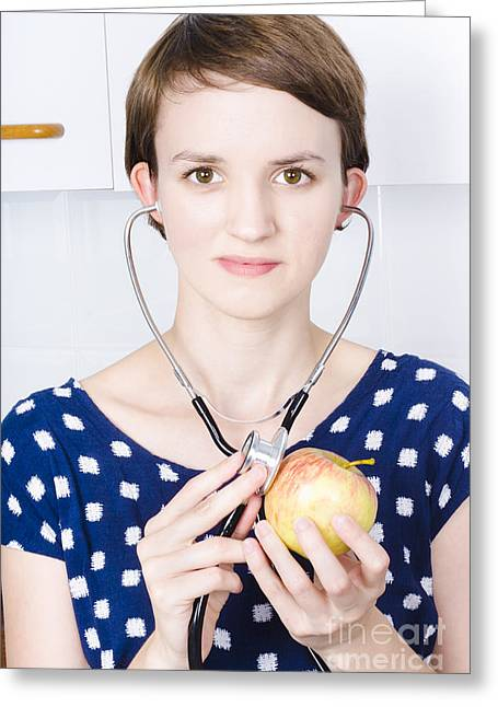 Young Woman Doctor With Apple Greeting Card by Jorgo Photography - Wall Art Gallery
