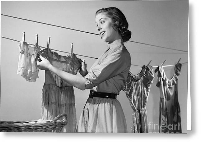 Young Woman Hanging Clothes To Dry Greeting Card
