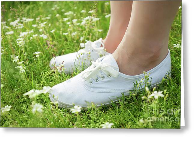 Young Woman In White Classic Sneakers Standing In Grass On Spring Meadow Greeting Card by Michal Bednarek