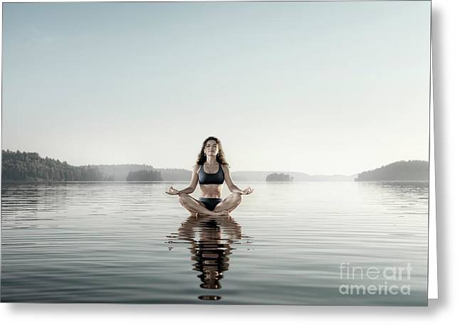 Young Woman Meditating On Platform In The Water Greeting Card