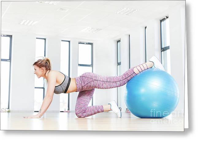 Young Woman Training With Fitball At Fitness Club. Greeting Card
