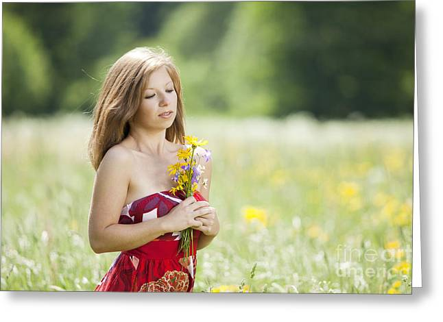 Young Woman With Flowers In Her Hand In A Meadow Greeting Card by Wolfgang Steiner