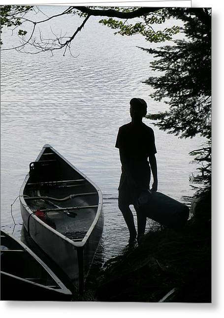 Youth With Canoe Greeting Card by Jim DeLillo