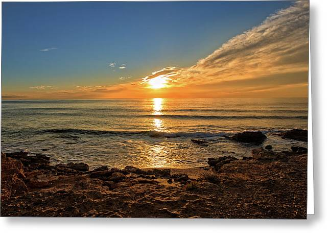 The Calm Sea In A Very Cloudy Sunset Greeting Card