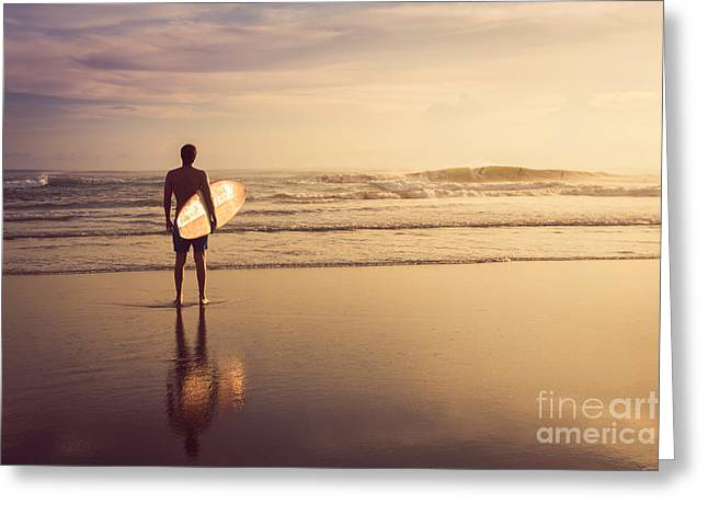 A Man Is Standing With A Surf In His Greeting Card by Mariia Smeshkova