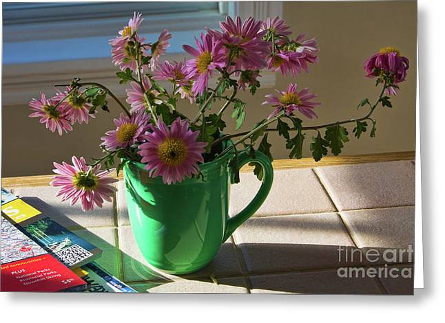 Greeting Card featuring the photograph A Traveler Still Life With Autumn Flowers by Tatiana Travelways