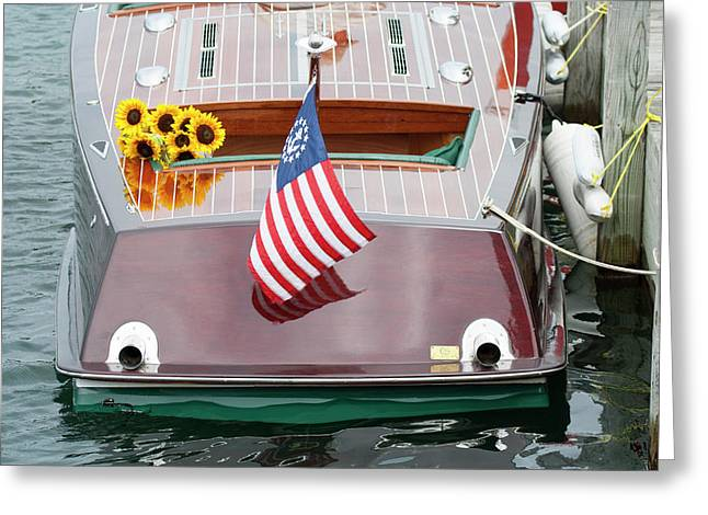Greeting Card featuring the photograph Antique Wooden Boat With Flag And Flowers 1304 by Rick Veldman