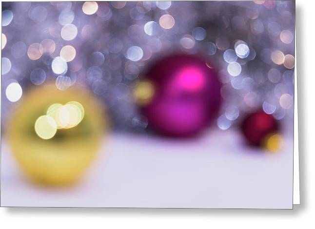 Greeting Card featuring the photograph Blurry Christmas Background With Christmas Balls And Bokeh by Cristina Stefan