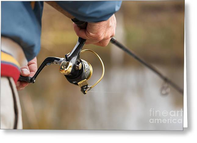 Closeup Of Fisherman`s Hand With Greeting Card