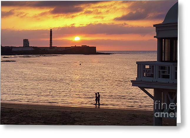 Greeting Card featuring the photograph Couple At Sunset In La Caleta Cadiz Spain by Pablo Avanzini