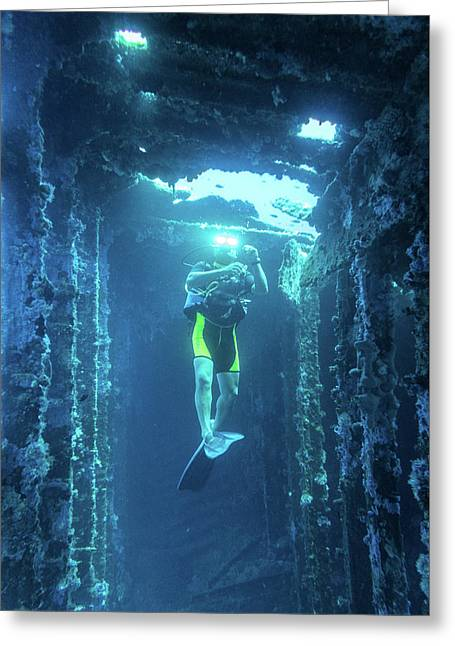 Greeting Card featuring the photograph Diver In The Patris Shipwreck by Milan Ljubisavljevic