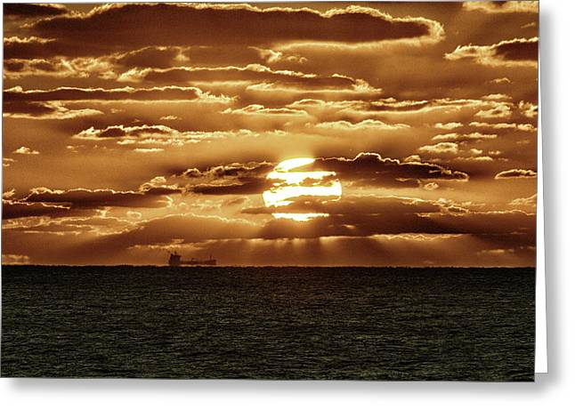 Greeting Card featuring the photograph Dramatic Atlantic Sunrise With Ghost Freighter In Goldtone by Bill Swartwout Fine Art Photography