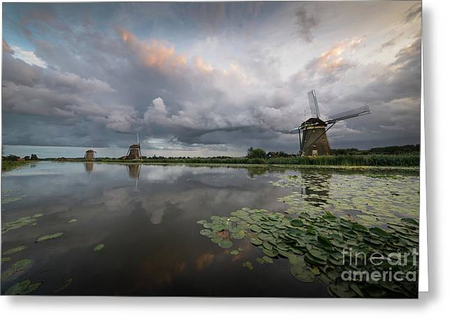 Greeting Card featuring the photograph Dramatic Sky Over Three Windmills In Holland by IPics Photography