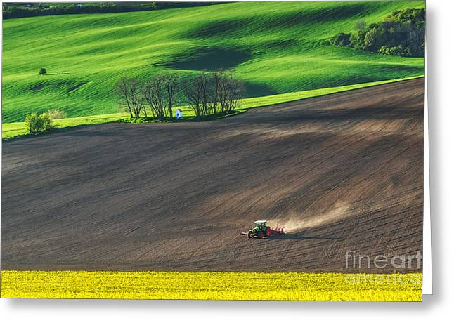 Farm Tractor Handles Earth On Field - Greeting Card