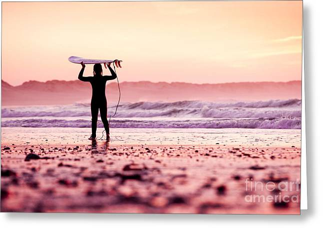 Female Surfer On The Beach At The Sunset Greeting Card
