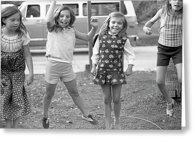 Four Girls, Jumping, 1972 Greeting Card