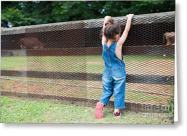 Girl Playing Wearing Overalls Greeting Card