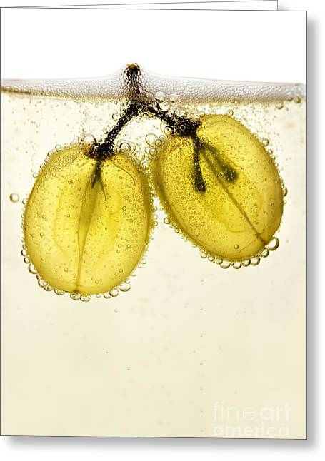 Grapes Floating In Champagne Creating Greeting Card