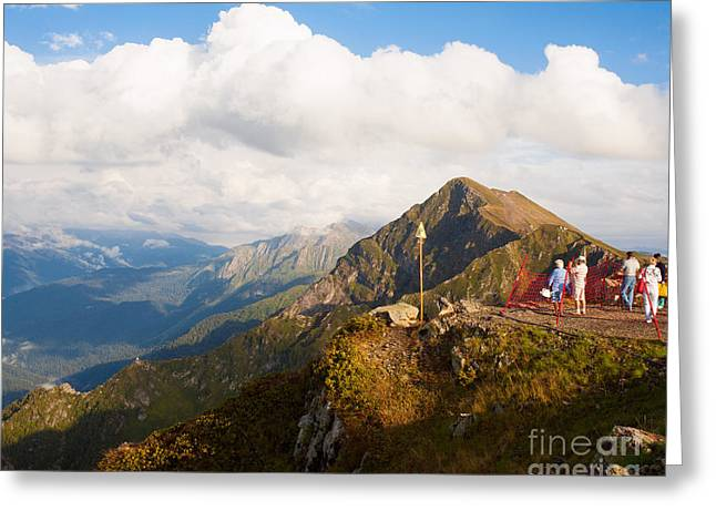 Group Of Tourists On Mountain Top In Greeting Card
