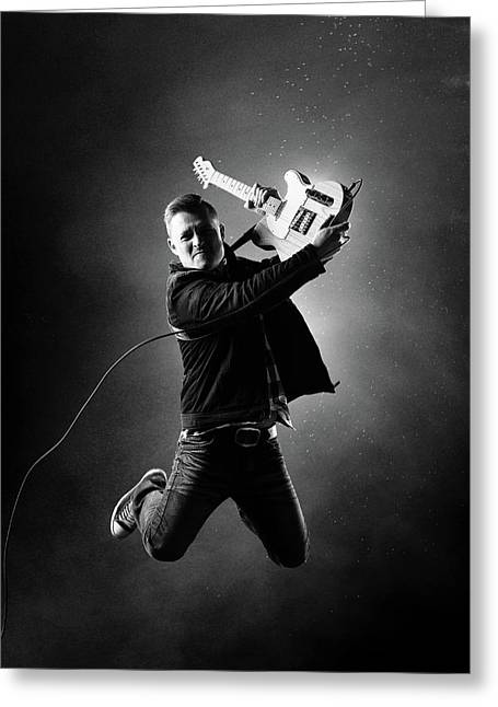 Guitarist Jumping High Greeting Card