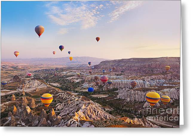 Hot Air Balloon Flying Over Rock Greeting Card