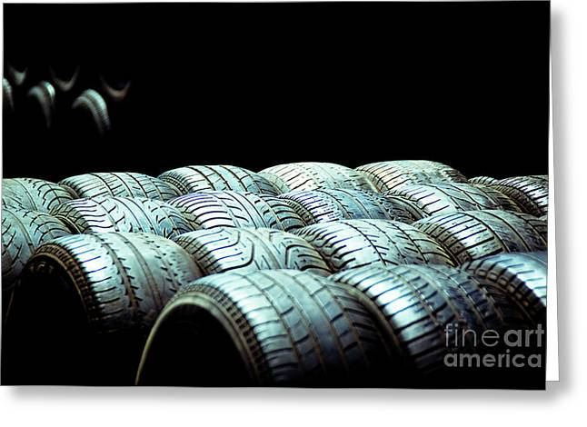 Old Tires And Racing Wheels Stacked In The Sun Greeting Card